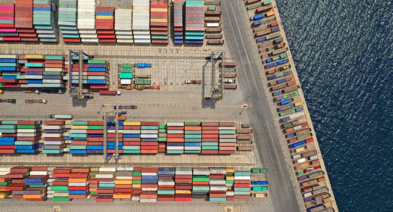 container, cargo, city, shipping, port, export, business, transport, freight, industry, ship, import, urban, containers, industrial, architecture, terminal, sea, transportation, trade, dock, harbor, town, cityscape, warehouse, commercial, aerial view, bulk, commerce, construction, container ship, crane, delivery, global, goods, harbour, heavy, international, loading, logistics